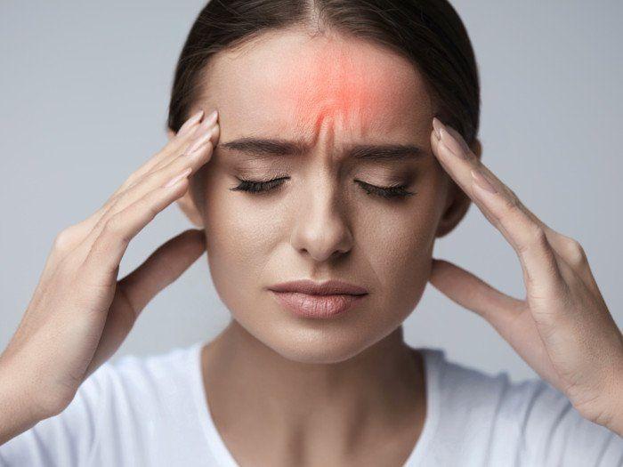 Nhức đầu, ê buốt răng, người mệt mỏi là dấu hiệu bình thường sau khi niềng răng.
